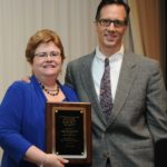 Dr. Lisa Robertson Presents Award to Dr. Brian Michuluck