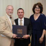 Dr. Loren Mangino Accepts Diploma from Dr. Rick English